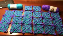 Twenty granny squares with purple accent crosses
