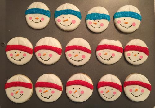 Step three of the snowmen faces: noses, mouths, and hat brims.